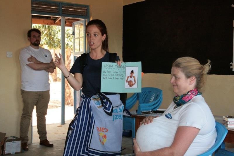 """Cristina Sansalvador doing a workshop with colleague Anna playing a pregnant woman."""