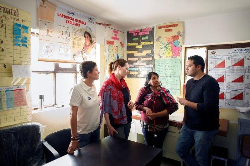 Fernando Sepulveda and his colleagues talking in a Bolivian healthcare centre.