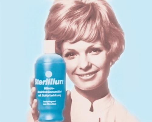 Historical advertisement picture portraying woman holding Sterillium