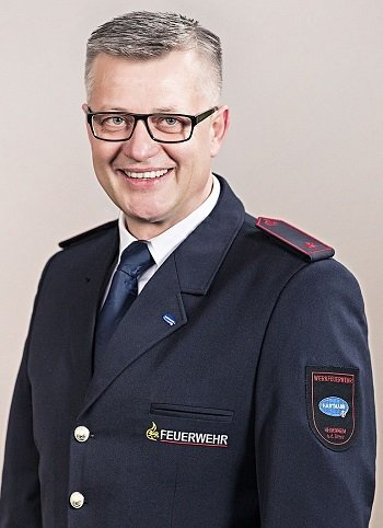 Portrait shot of Pawel Wojcik in his uniform.