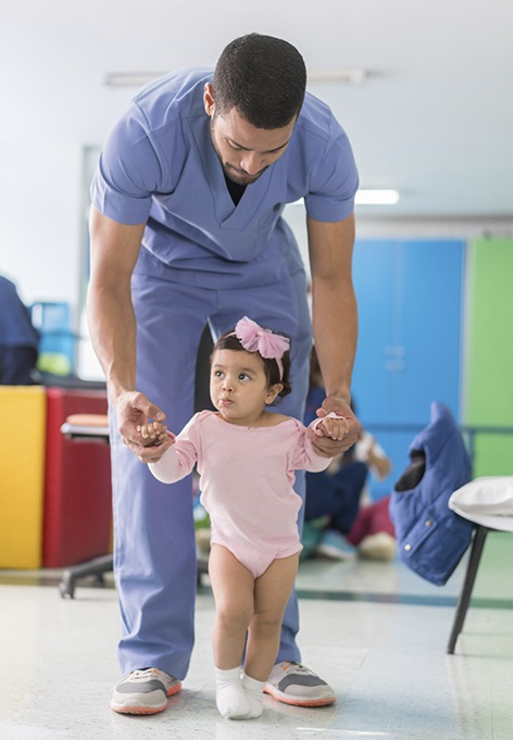nurse with a little kid in pink dress