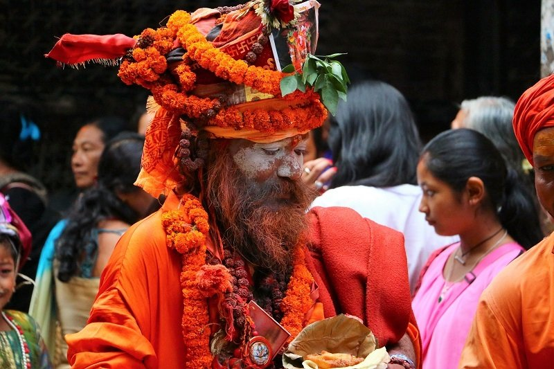 Picture of Nepalese man painted with traditional religious colours.