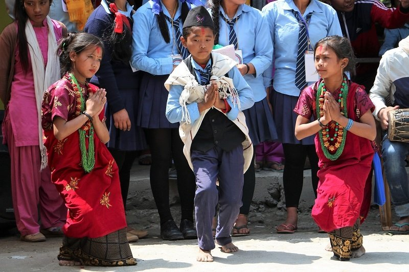 Nepalese kids dancing at festival.