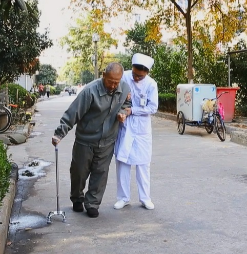 Chinese nurse helping the patient.