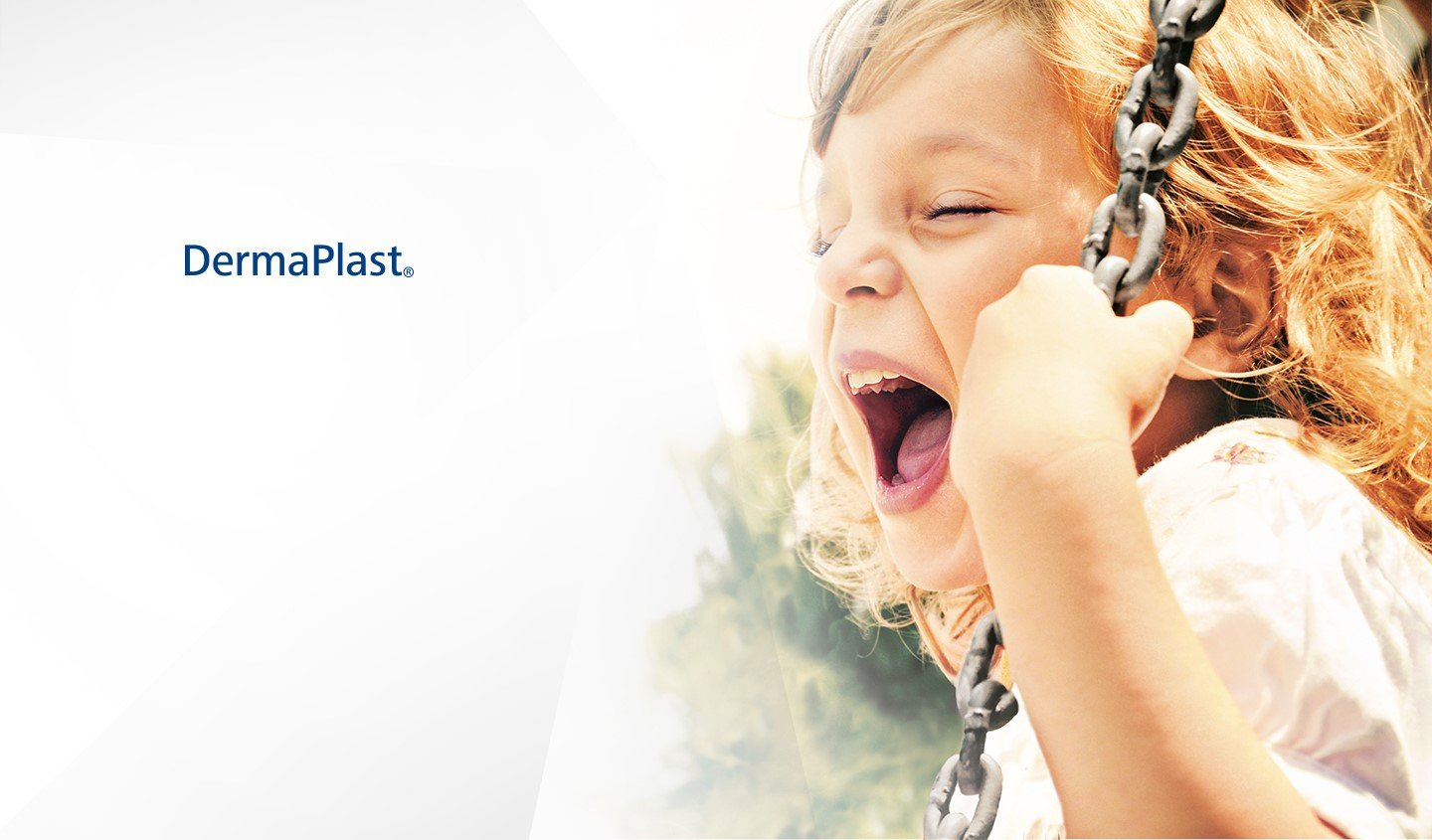 DermaPlast® girl on swing with mouth wide open screaming and laughing.