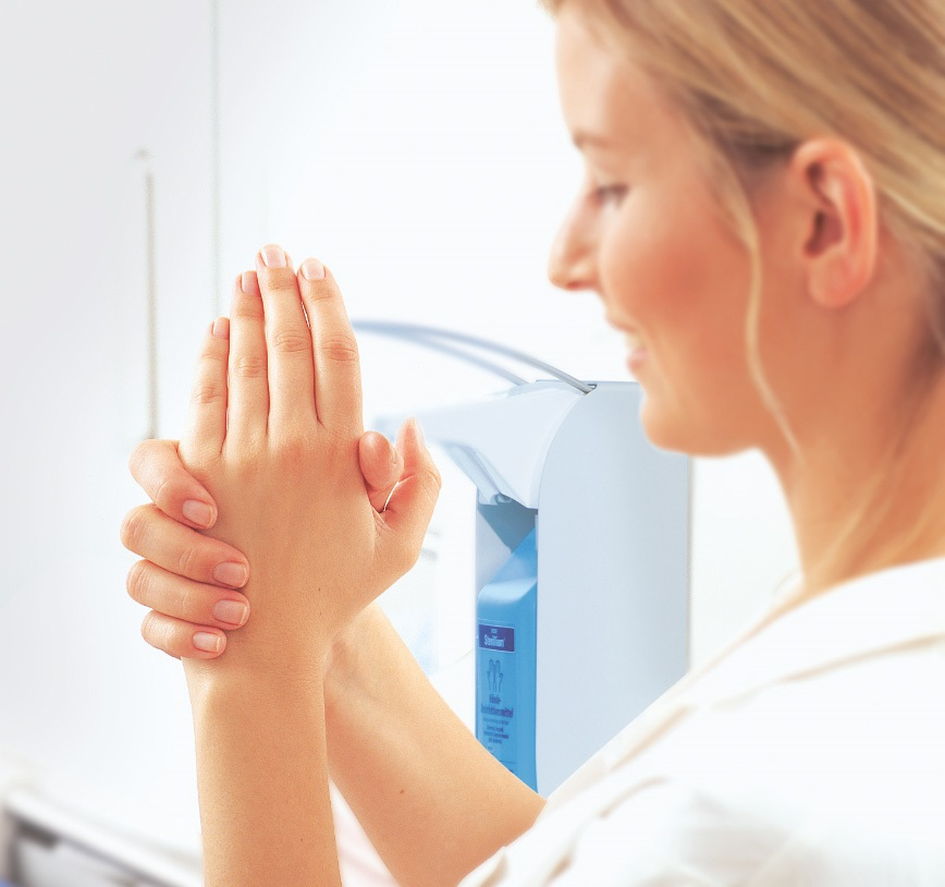 Woman is disinfecting her hands