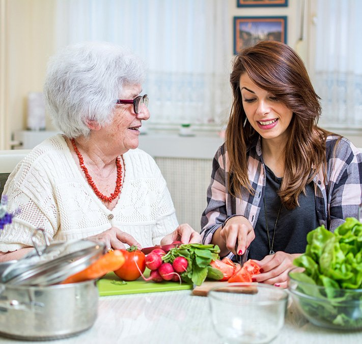older woman with daughter at cooking