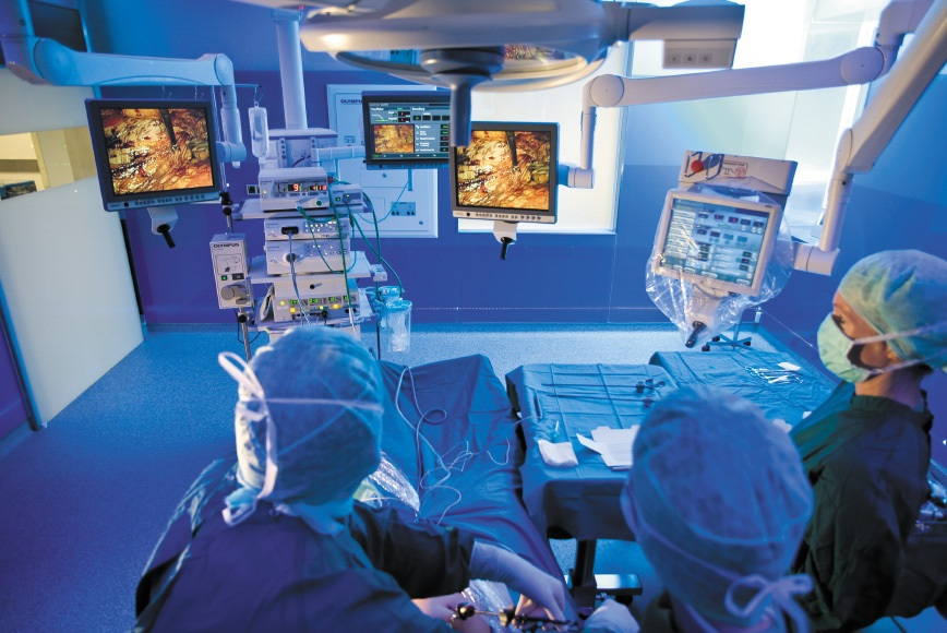 """surgery room with a lot of surgical instruments and some surgeons"