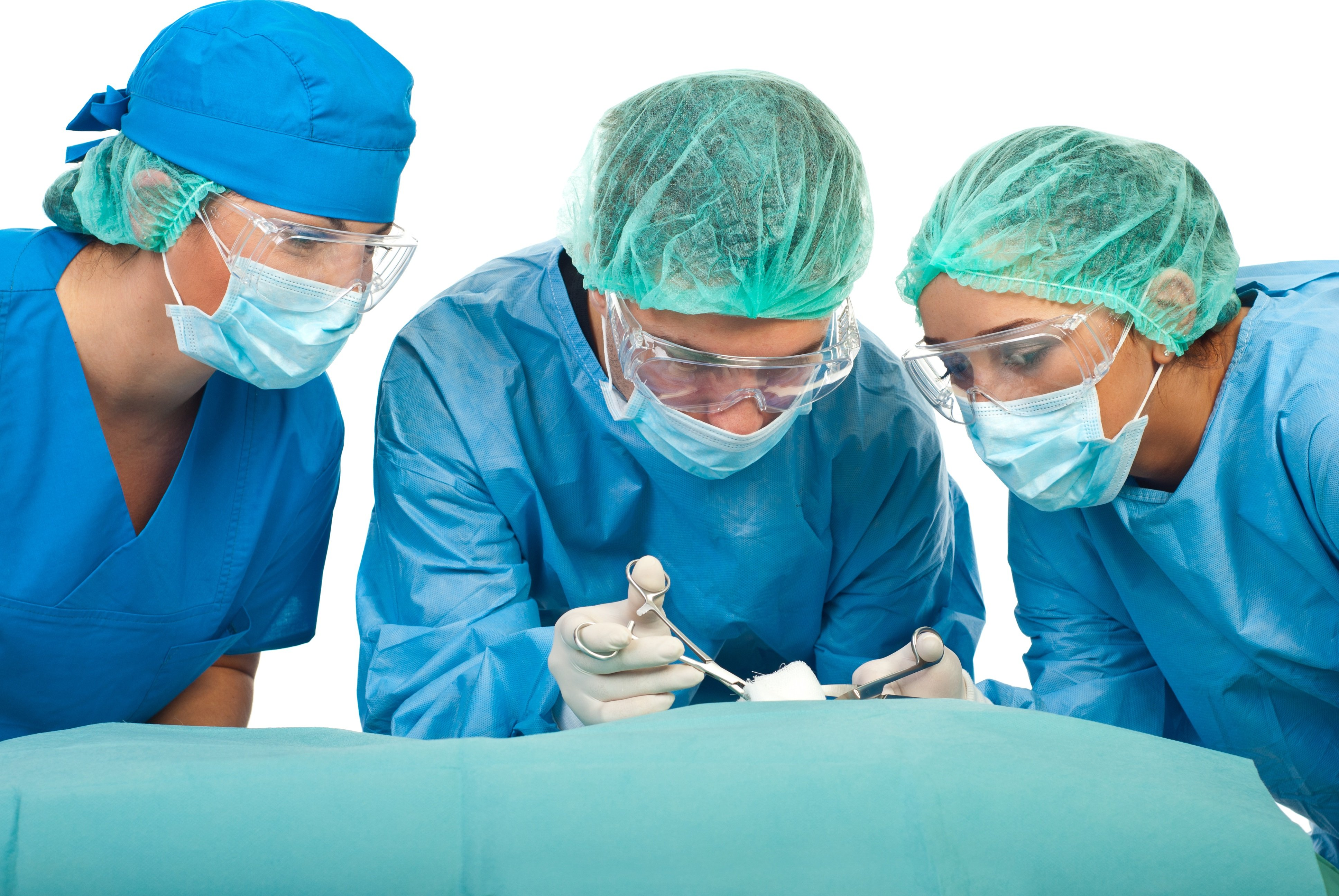 three surgeons doing a surgery wearing blue gowns and head and