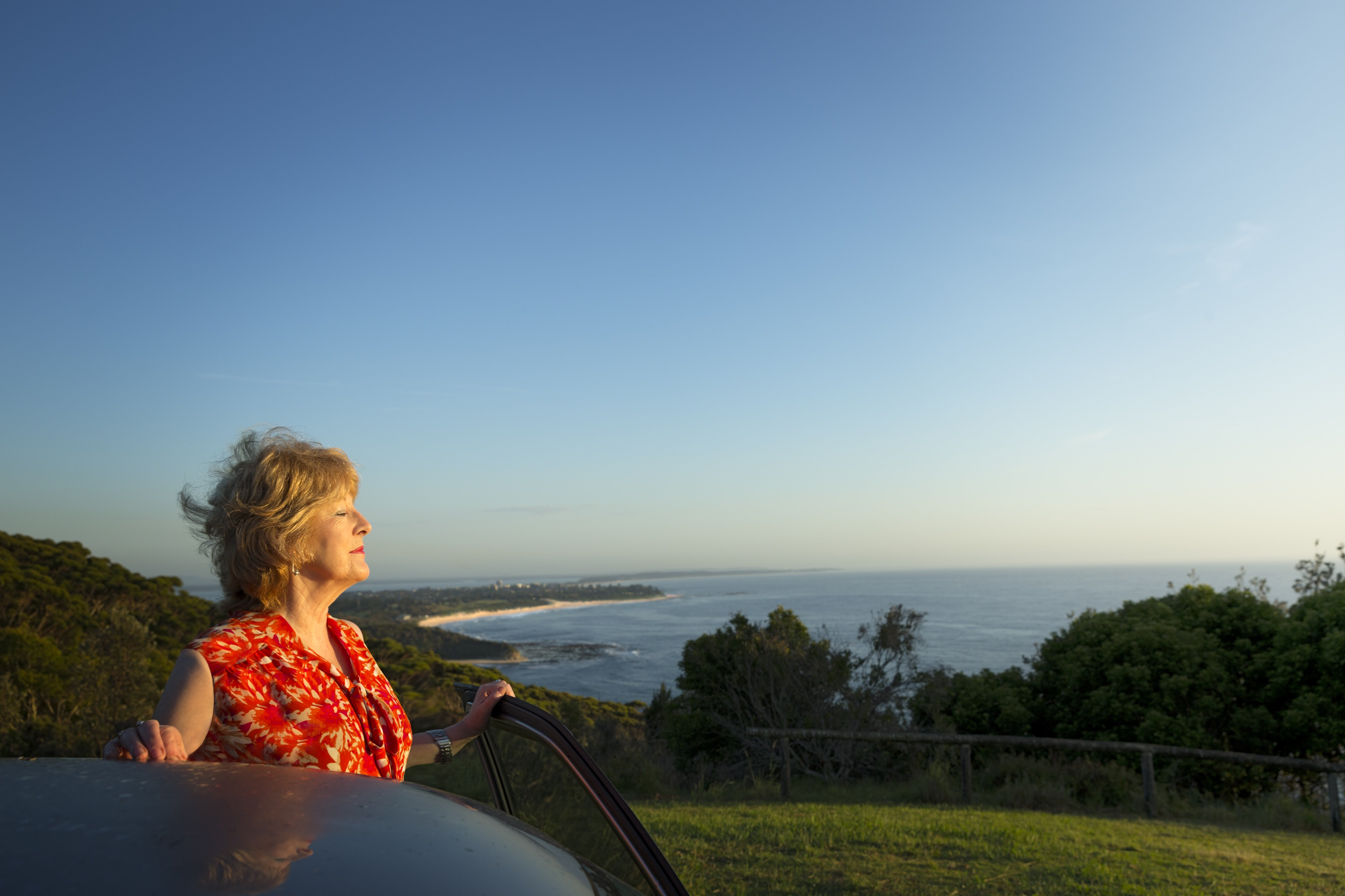 woman enjoying the view of the ocean and landscape