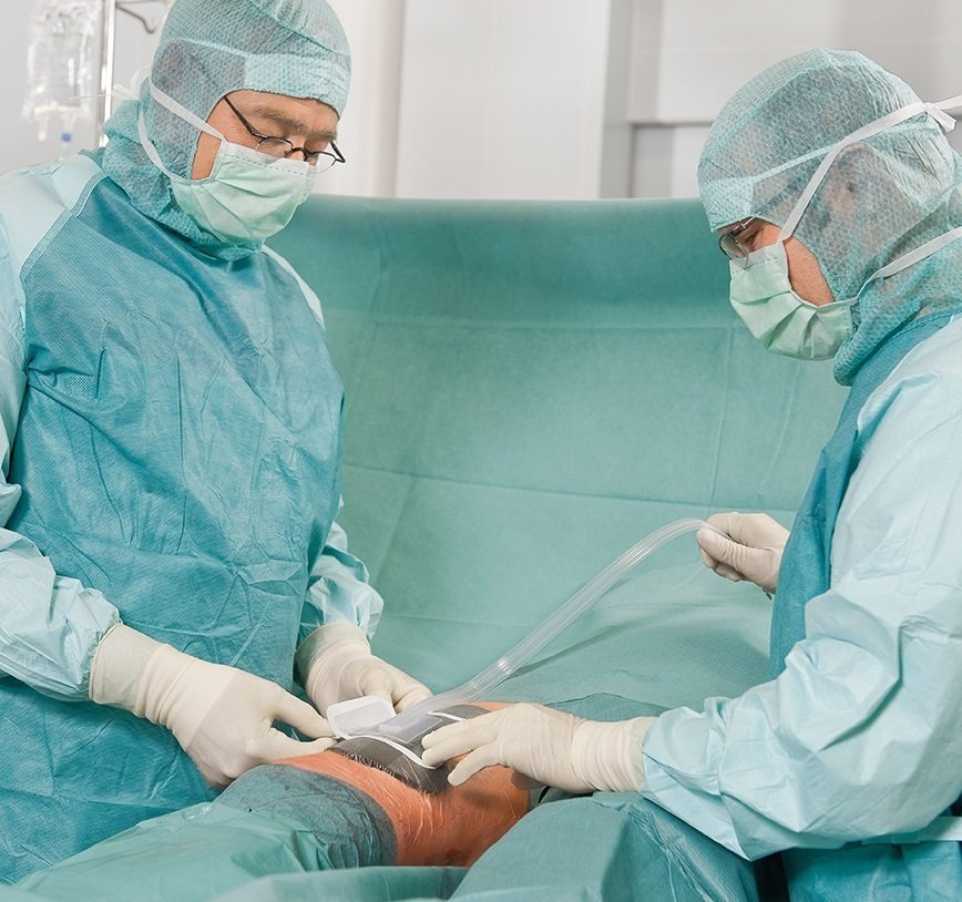 Two doctors performing operation