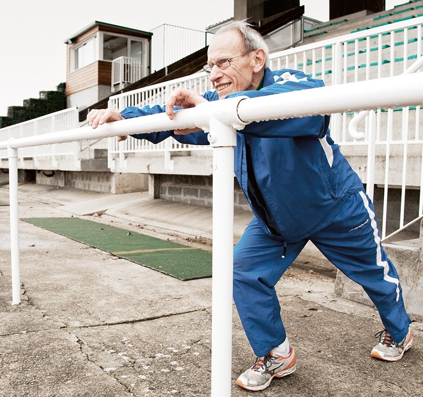 Elderly man stretching